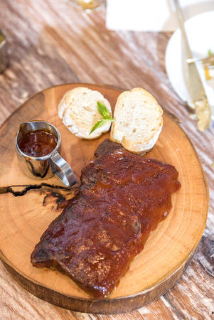 Grilled Barbecued Pork Baby Back Ribs served with bread Stock Photo