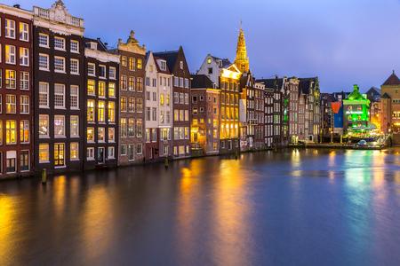 Amsterdam Canals and Saint Nicholas church at dusk Netherlands