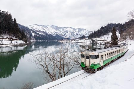 Train in Winter landscape snow on bridge Stock Photo