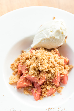 Apple crumble with Ice-cream and cinnamon powder