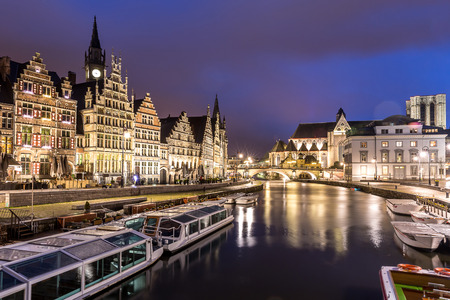 Picturesque medieval buildings on Leie river in Ghent town, Belgium at dusk. Stock Photo