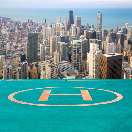 Aerial view of Chicago City downtown with helipad airport