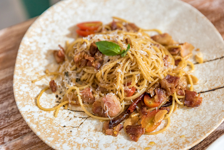 Pasta Carbonara. Spaghetti with bacon, parsel and parmesan cheese.  Italian food cuisine