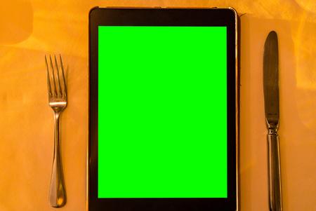 Tablet using as menu in restaurant Stock Photo