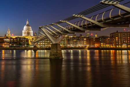 St paul cathedral with millennium bridge sunset twilight in London UK. Stock Photo