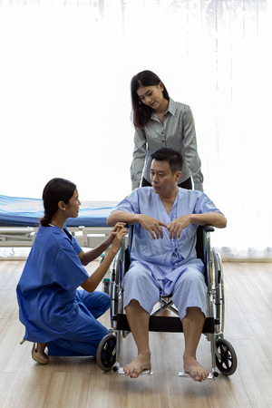 Physical therapist explain treatment method to senior patient and relative