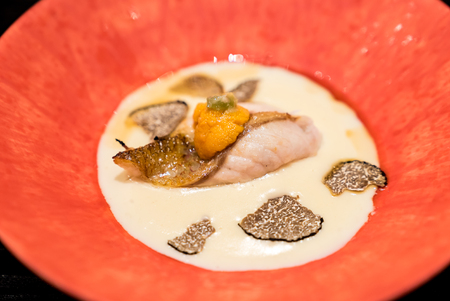 Grilled dish : Grilled rosy seabass with sea urchin in creamy truffle Stock Photo
