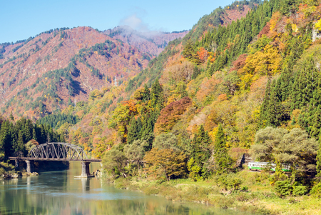 Autumn fall foliage Fukushima Tadami Black Bridge View Point in Fukushima Japan Stock Photo