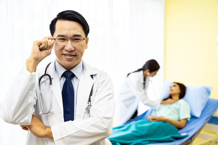 Portrait of Young adult Doctor with nurse and Patient Stock Photo