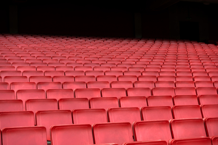 Empty Red seat row in football soccer stadium