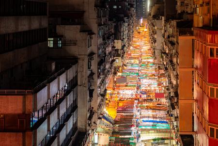 Aerial View of Temple street night flea market illumination in Kowloon Hong Kong Banco de Imagens