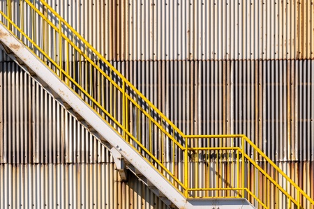 exterior of metal sheet warehouse wall and fire exit stair