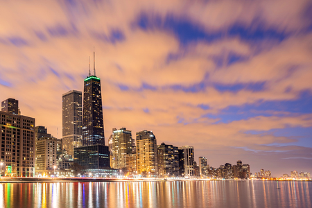 Sunset at Chicago Skylines building at Chicago downtown along Lake Michigan in Chicago City Illinois USA. Take from Ohio Street beach Milton Lee Olive Park. Stock Photo