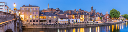 Panorama York cityscape along river ouse sunset dusk, York Yorkshire England UK.