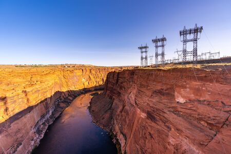 Power plant house and power line over Electricity generating dam with river colorado in Page Arizona USA Reklamní fotografie
