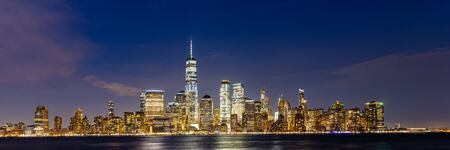 New York city Lower Manhattan skyline cityscape at dusk from New Jersey.