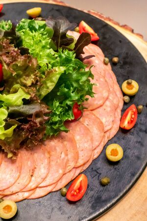 Variety of Cold cut, pork and beef salami, for salad station in buffet line