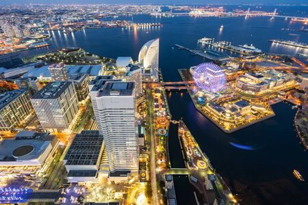 Aerial view of panoramic modern city in Yokohama City Japan with blue hour after sunset in th evening. Yokohama is the second largest city in Japan by population.