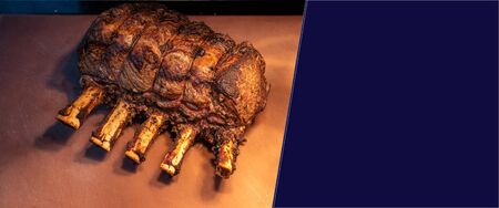 Wagyu beef roast prime rib, Carving food, panoramic crop for web banner
