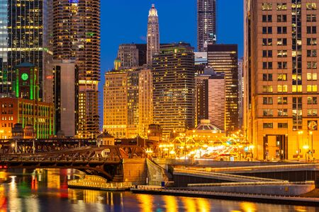 City of Chicago downtown and Chicago River sunset night in Chicago Illinois USA. Reklamní fotografie