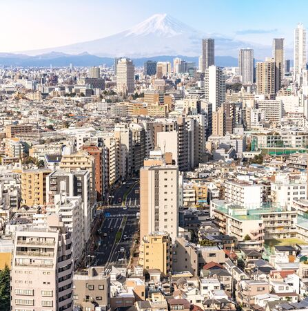 aerial view of Tokyo skylines and skyscrapers buildings in Shinjuku ward in Tokyo with Mountain Fuji in background