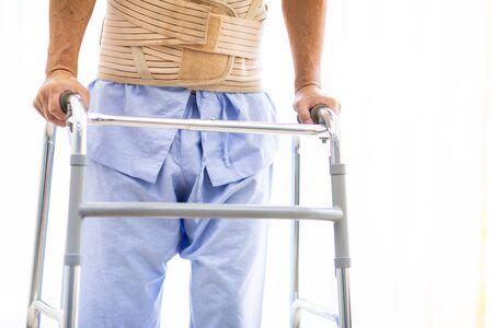 closeup of  elderly using adult walker in hospital