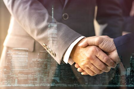 Double exposure of business Handshake with new york manhattan skyline building background Reklamní fotografie