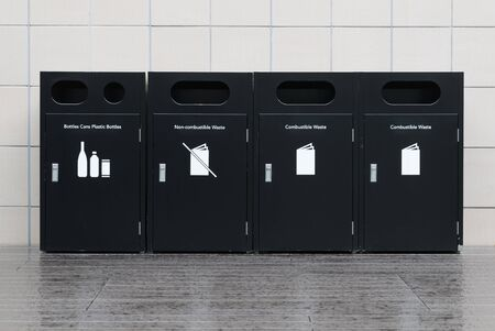 Recycle bins for rubbish, recycling and garden waste, over white wall background