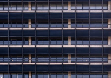 Urban abstract - window facade of business center office building with reflections and colours. Philadelphia PA USA Stock Photo
