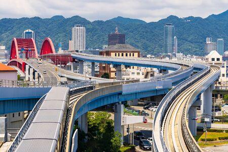 monorail track and highway red bridge to Kobe downtown Hyogo Kansai Japan