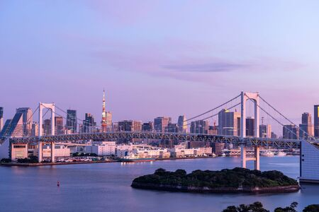 Aerial view of Tokyo skylines with Rainbow bridge and tokyo tower over Tokyo bay Sunrise dawn Twilight from Odaiba in Tokyo city Kanto Japan. Stock fotó