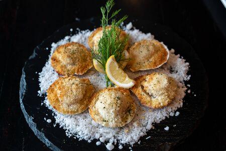 deep fried Hokkaido Scallops Shell with crusty bread serve with lemon and salt.