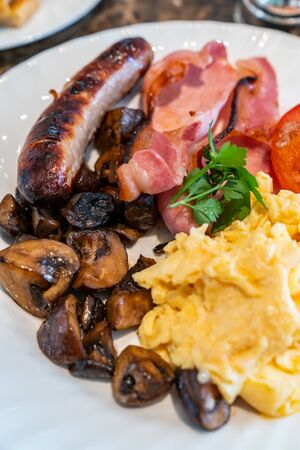 Full English Breakfast on Table with coffee