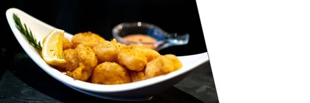 Deep fried shrimp ball with lemon and dipping sauce. Panoramic crop designed for using as web banner Stockfoto - 130073061