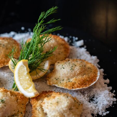 deep fried Hokkaido Scallops Shell with crusty bread serve with lemon and salt designed for square crop using. Imagens