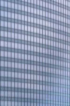 Urban abstract - window facade of business center office building with reflections and colours. Philadelphia PA USA 写真素材