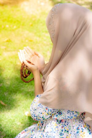 Young Adult teenager Woman making Duas for Muslim god blessing prayer.