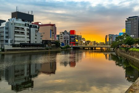 Fukuoka old town along naka river at Nakasukawabata sunset twilight. This area is favorite for tourist for Fukuoka Yatai, street Food stall,  for hangout at night.