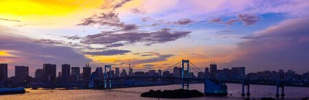 Panorama Aerial view of Tokyo skylines with Rainbow bridge and tokyo tower over Tokyo bay Sunset Twilight from Odaiba in Tokyo city Kanto Japan. Stock fotó