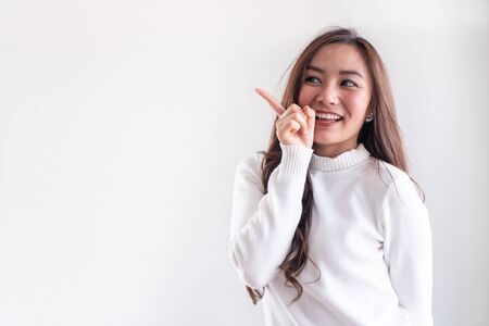 Portrait of good-looking beautiful young asian adult girl wearing white sweater for winter on white background
