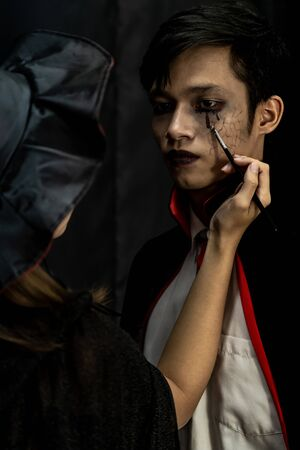 Makeup Artist do Asain teenager makeup for Halloween costume as Vampire  prepare for Carnival of Halloween Party Stock fotó