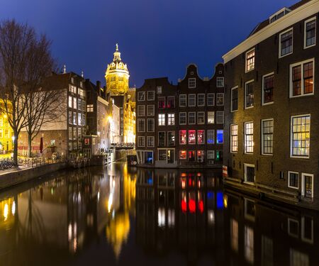 Amsterdam Canals and Saint Nicholas church sunset Netherlands Stock Photo