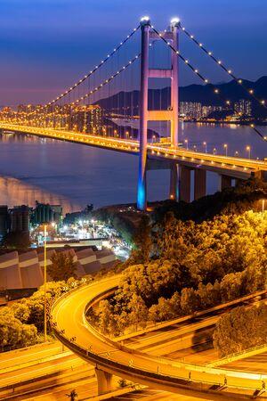 Sunset and light illumination of Tsing ma bridge landmark suspension bridge in Tsing yi area of Hong Kong China. Imagens
