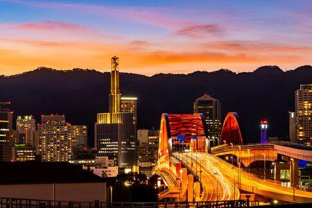 Sunset twilight monorail track and highway red bridge to Kobe downtown Hyogo Kansai Japan