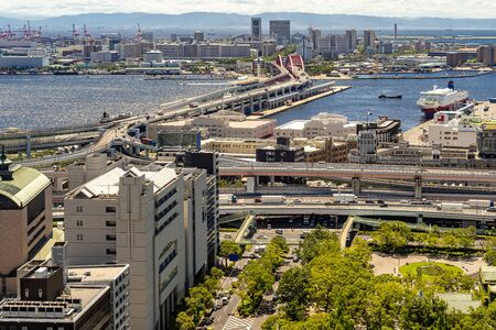 Aerial view of Kobe cityscape and red bridge at port area in Kobe downtown Hyogo Japan