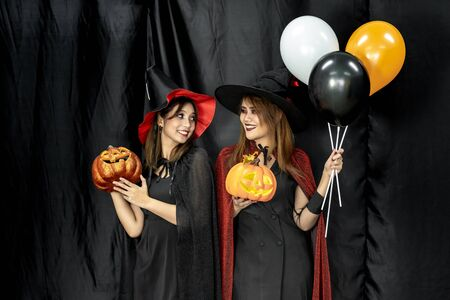 Two teenages and young adult girl women in Halloween costume for Halloween party background