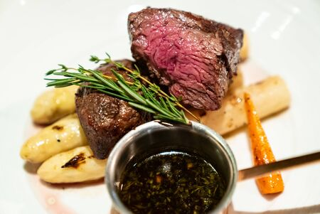 Grilled Beef Tenderloin wagyu with white asparagus decorate with edible flowers
