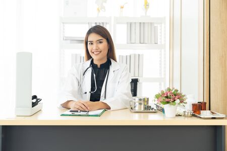 Portrait confident female doctor medical professional sitting in examination room in hospital clinic. Positive face expression Stok Fotoğraf