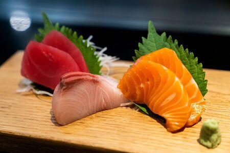 Sashimi traditional japanese cuisine, set of freshness raw salmon tuna and bass. Imagens