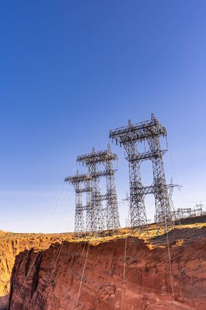 Power plant house and power line over Electricity generating dam in Page Arizona USA